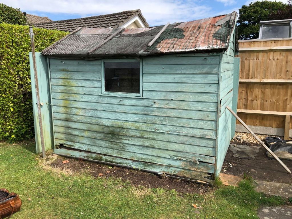 Removal of old shed and garden buildings